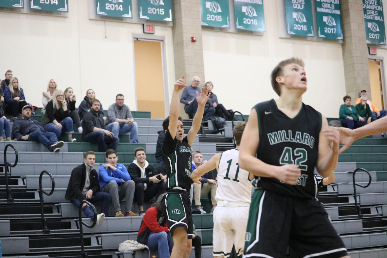 Sophomore Peyton Buscher shooting the three