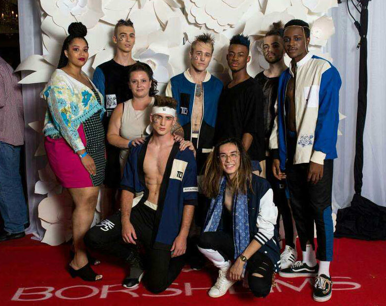 As Omaha Fashion Week comes to a close, Austin Do and a few of his models pose for a photo.