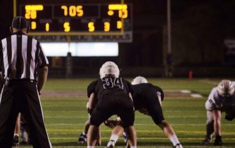 Senior Joshua Main analyzing the quarterback waiting to make a tackle