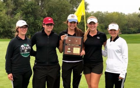 Girls golf holds their first ever Districts trophy