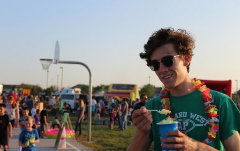 Junior Logan Hawkins enjoys a snow cone while volunteering