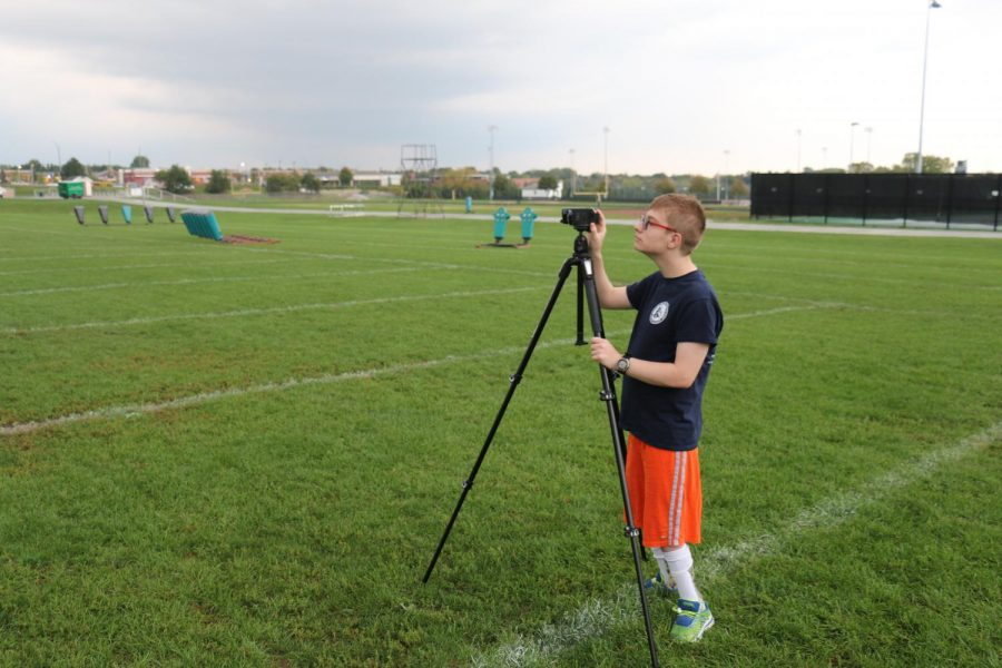Rogers films practice as he focuses on his new daily job. Filming is a thankless job thats very important to the team, Young said. We really appreciate his help.