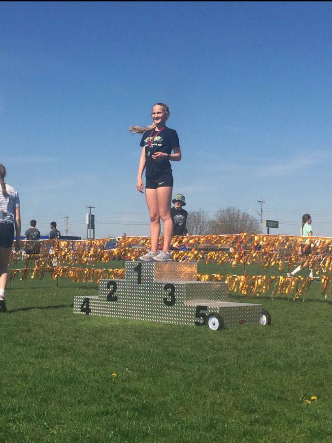 Gabby McGinn after running her 5k race and winning first place.