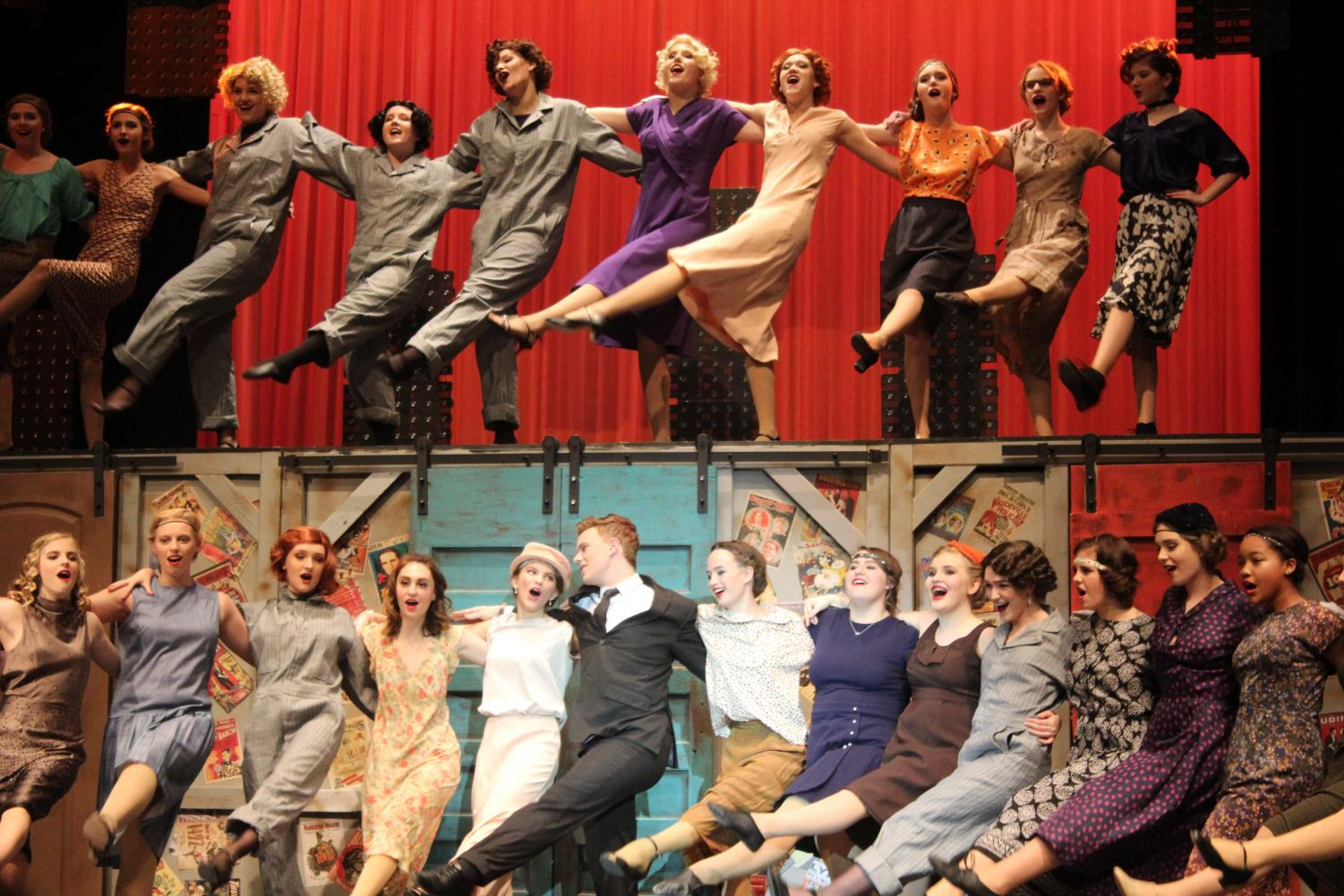 The+cast+lines+up+for+a+dramatic+kick-line