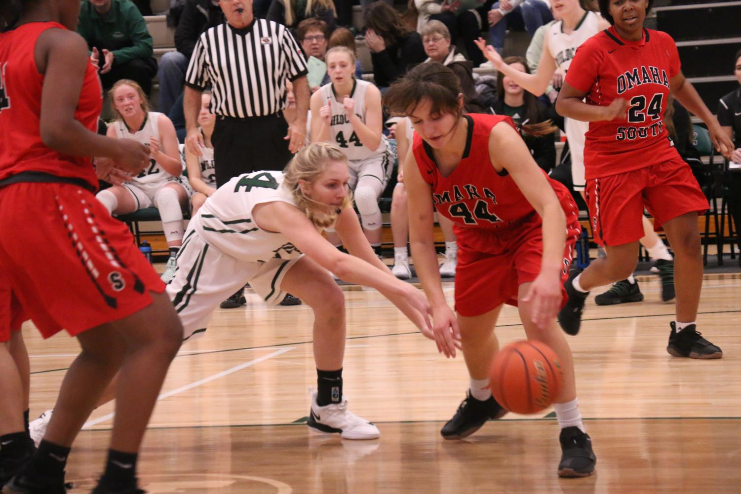 Laney Schipper fights for the basketball.