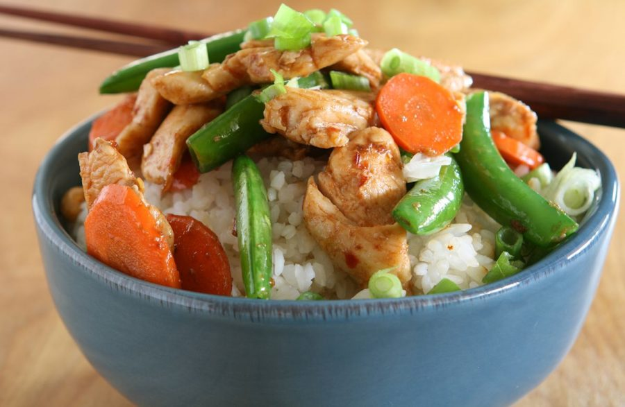Brown rice with chicken and steamed veggies.