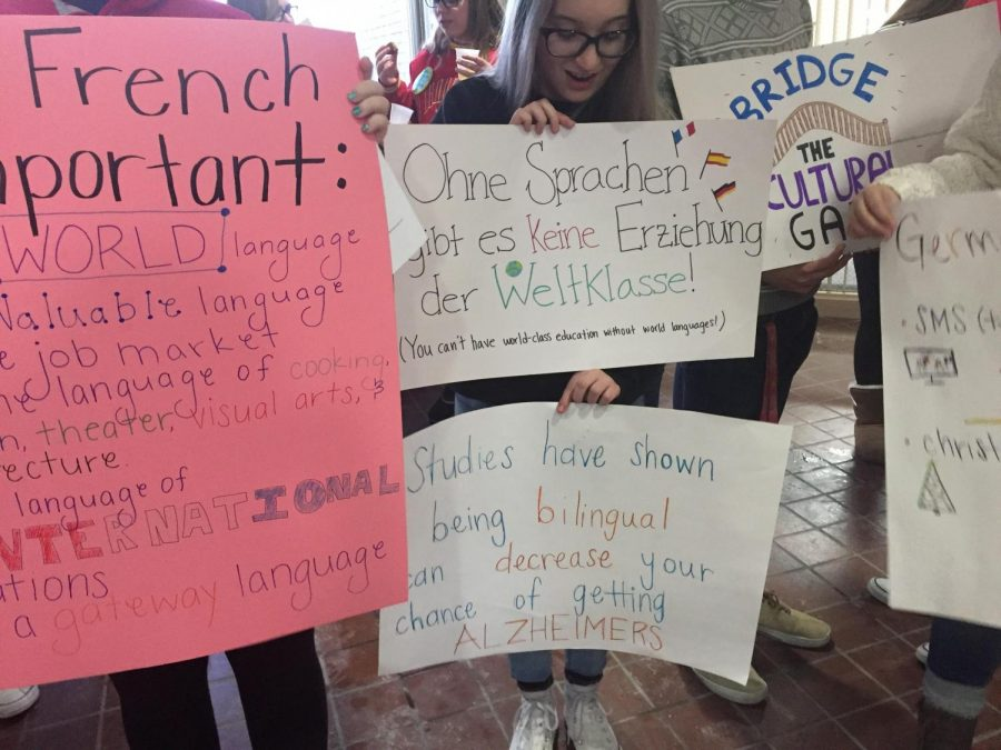 Students+wield+signs+and+slogans+outside+of+the+February+School+Board+meeting.+