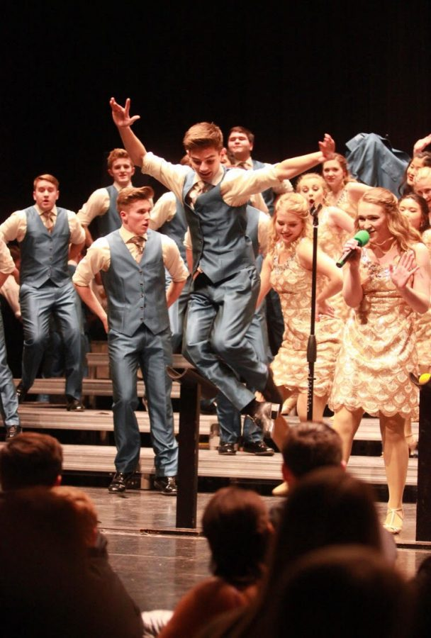 Sophomore+Alec+Brown+performs+a+solo+tap+dance+during+the+show+choir+show