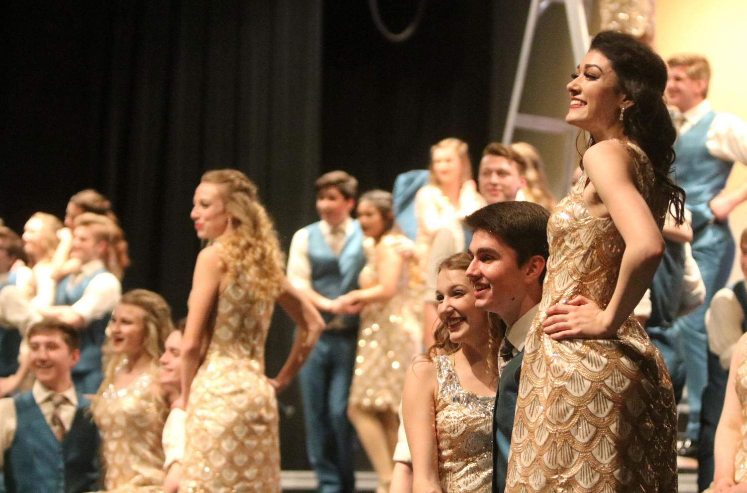 Seniors+Gavin+Hatch+and+Lauren+Dubas+smile+at+the+end+of+their+breathtaking+performance.+