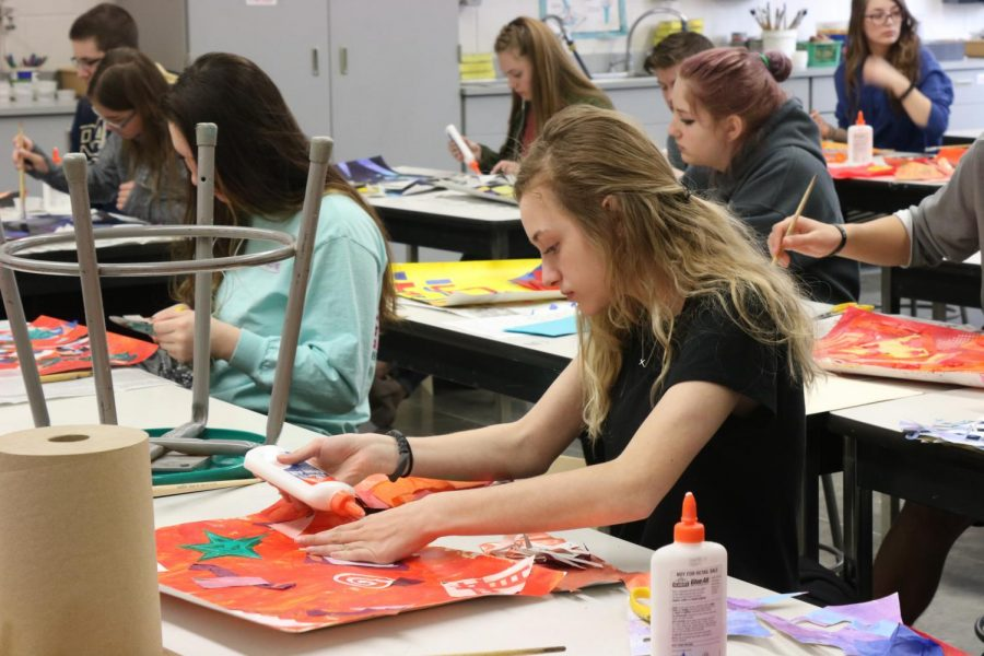 Freshman Drew Heller works on her project for Art Foundations.  The class learned about the elements and principles of art and applied that knowledge to create masterpieces. I signed up for this class because I thought it would be fun and a good way to express myself, Heller said. My favorite part is getting to use new materials and explore new techniques for art.