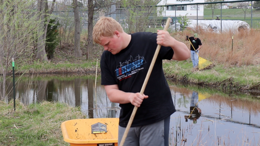 Junior Gavin Cross partcipates in the biannual cleanup of the pond on Sunday May 6, 2018. Eco West members, staff and their families showed up to help.