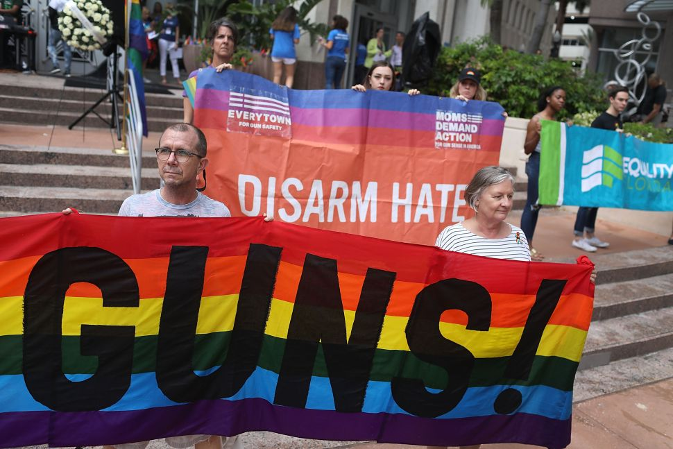 ORLANDO, FL - JUNE 11:  People join together during a rally for Pulse nightclub and Marjory Stoneman Douglas High School shooting victims in front of Orlando City Hall on June 11, 2018 in Orlando, Florida. Pulse nightclub and Marjory Stoneman Douglas High School shooting survivors held the rally to demand political leaders stop the epidemic of gun violence as well as reject NRA influence and help the communities around the country that have experienced mass shootings. (Photo by Joe Raedle/Getty Images)