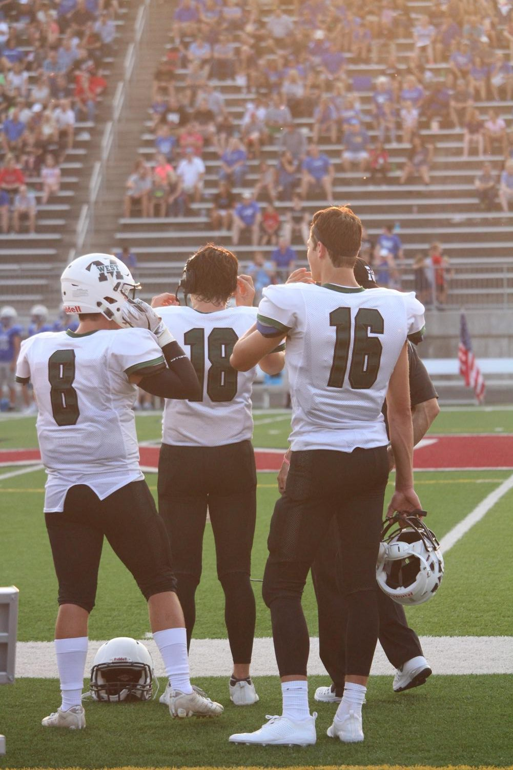 Nate Glantz (#18) prepares to get onto the field accompanied by Tristian Gomes (#16) on the sideline.