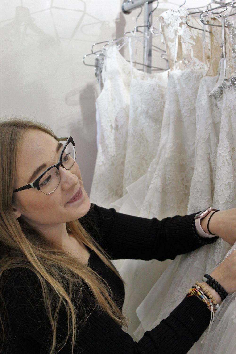In the little botique of Spotlight Formal Wear lies an array of dresses. Here senior Elizabeth Sook searches the racks, hoping to find the perfect dress for her bride, druing the consultation.