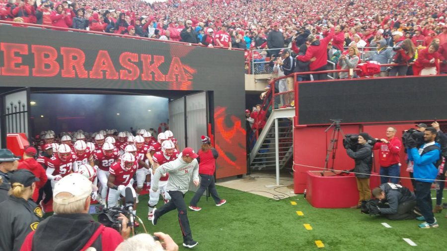 Nebraska+Head+Coach+Scott+Frost+leads+his+team+out+on+to+the+field.