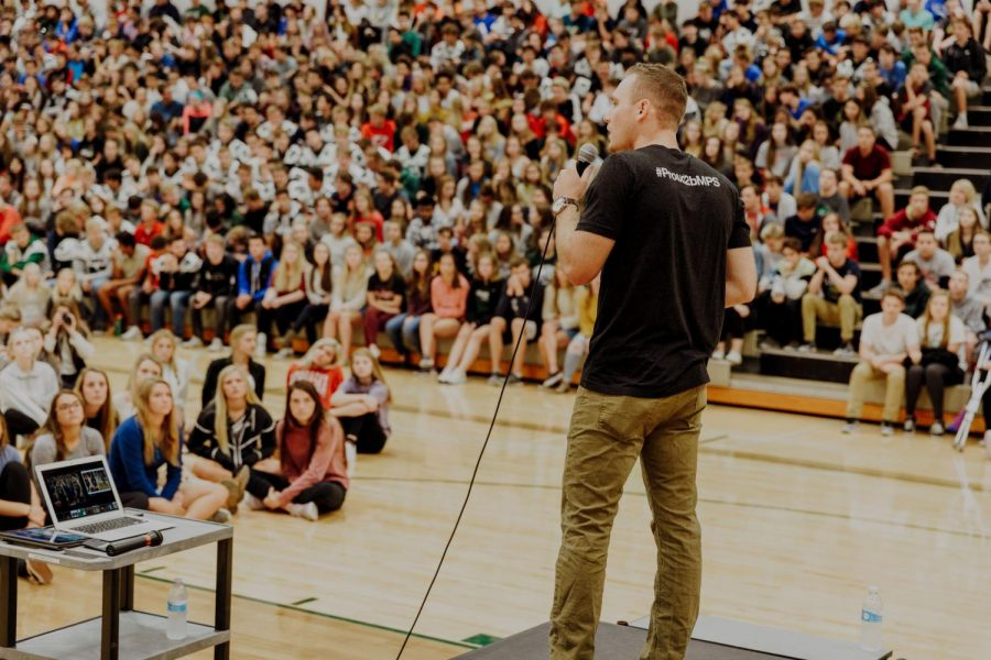 %22Kyler+Erickson+speaks+at+an+all-school+assembly.+Erickson+was+invited+as+a+guest+speaker+to+inform+the+student+body+about+the+%23BeKind+campaign.+%22Students+can+use+the+%23BeKind+campaign+to+talk+to+unpopular+kids+more+often%2C+to+sit+by+someone+new+at+lunch%2C+or+to+donate+their+time+to+someone+or+something+in+need%2C%22+Erickson+said.+%22They+will+feel+a+deeper+fulfillment+than+when+thy%27re+living+for+their+own+self.%22