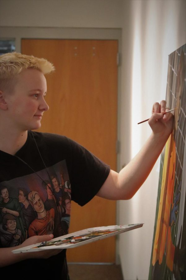 When taking an Advanced Studio, each student is given a two week period to complete their assigned project. Here, senior Adrian Judson completes one of his sport realism paintings. Each takes about a week to complete and is extremely detailed.