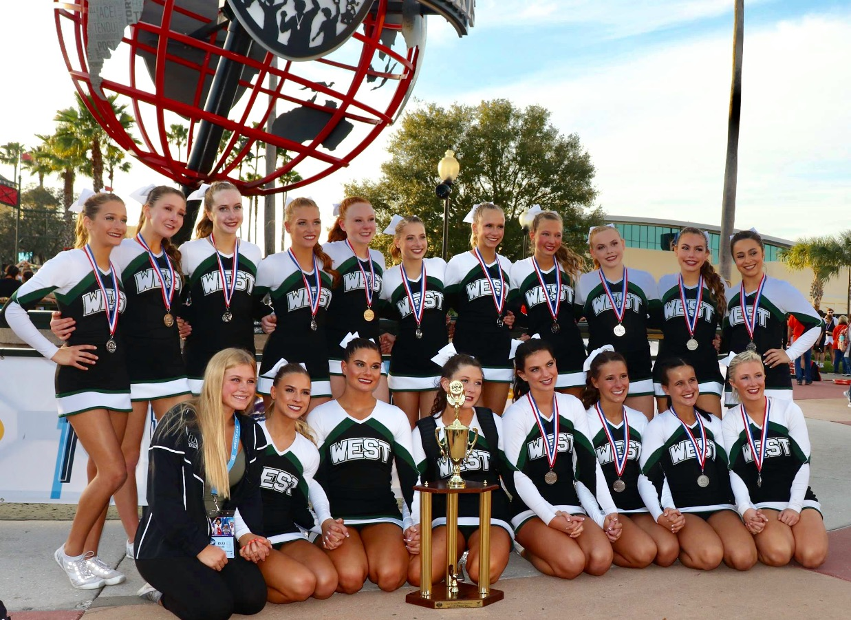 The Varsity Competition team poses infront of the ESPN Arena after winning second place in the Small Non-Building Varsity division.