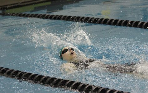 Sydney Hall finishing her backstroke during the annual Metro Swimming Conference