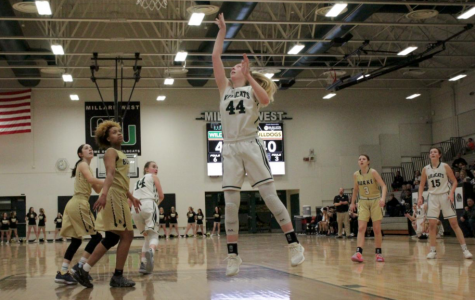 Junior Jenna Bohaty scores a wide open layup as Burke's small forward Aanaya Harris looks on.