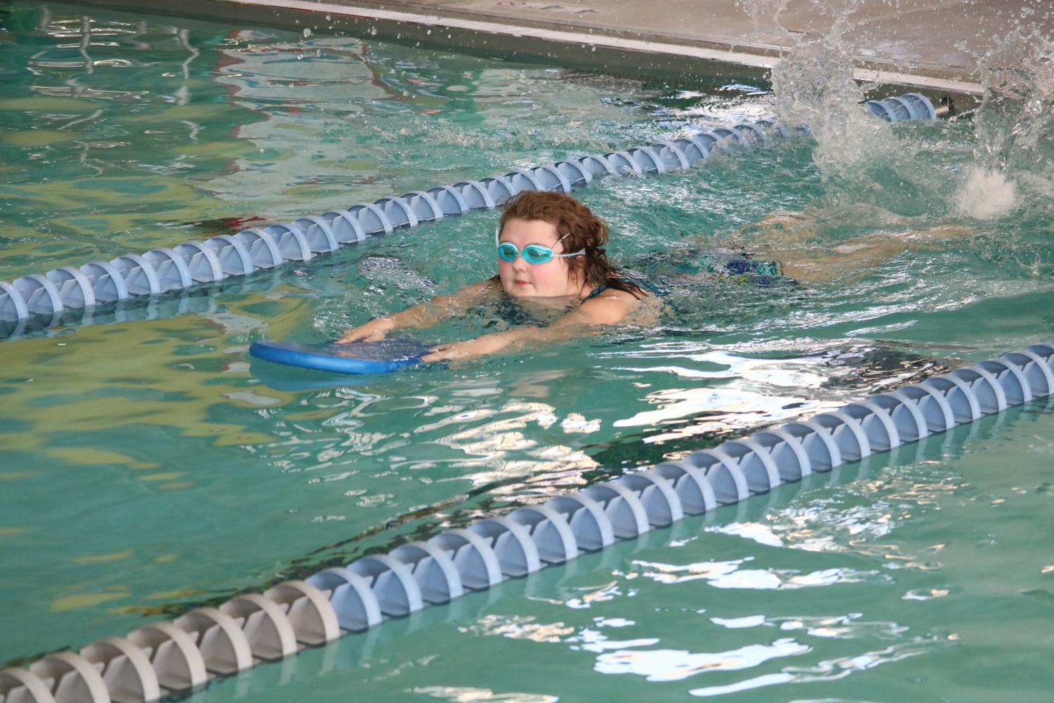 Swimming down the lane, junior Nathalie Ollerich competes in Unified Swimming. The students have been practicing in the evenings to prepare for competitions.