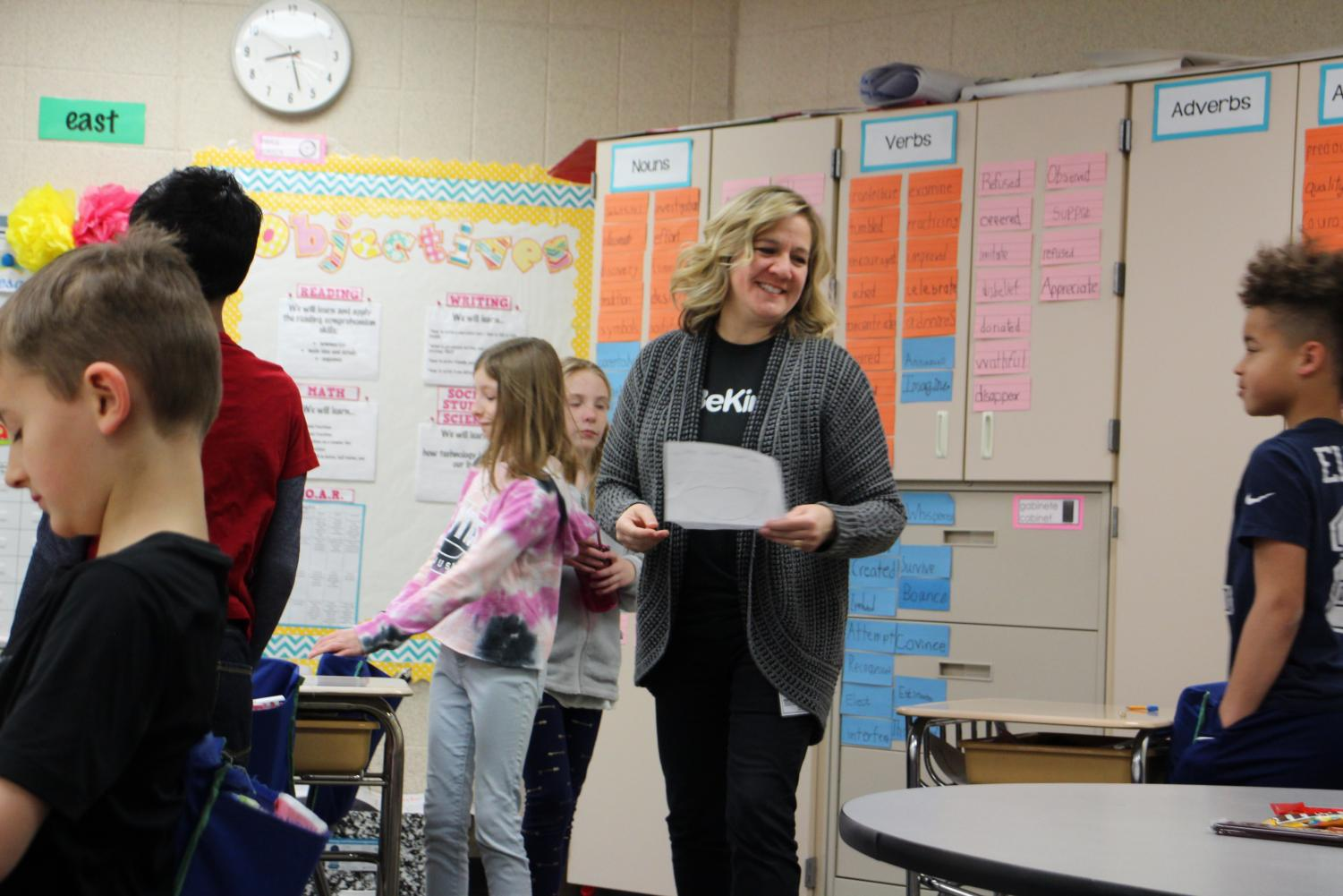 "Third Grade teacher, Gina Hill, teaches her students the reason behind the #BeKind campaign while they work on different projects. Her class, along with two other third grade classes finished writing letters to all the high school students in the 32 & Above Club. ""I would love to recruit more people to do this in the future,"" Hill said. ""I didn't realize the undertaking of it because I didn't know how many high school students were in the 32 & Above Club. It would be great to start getting more people involved. The more the merrier."""