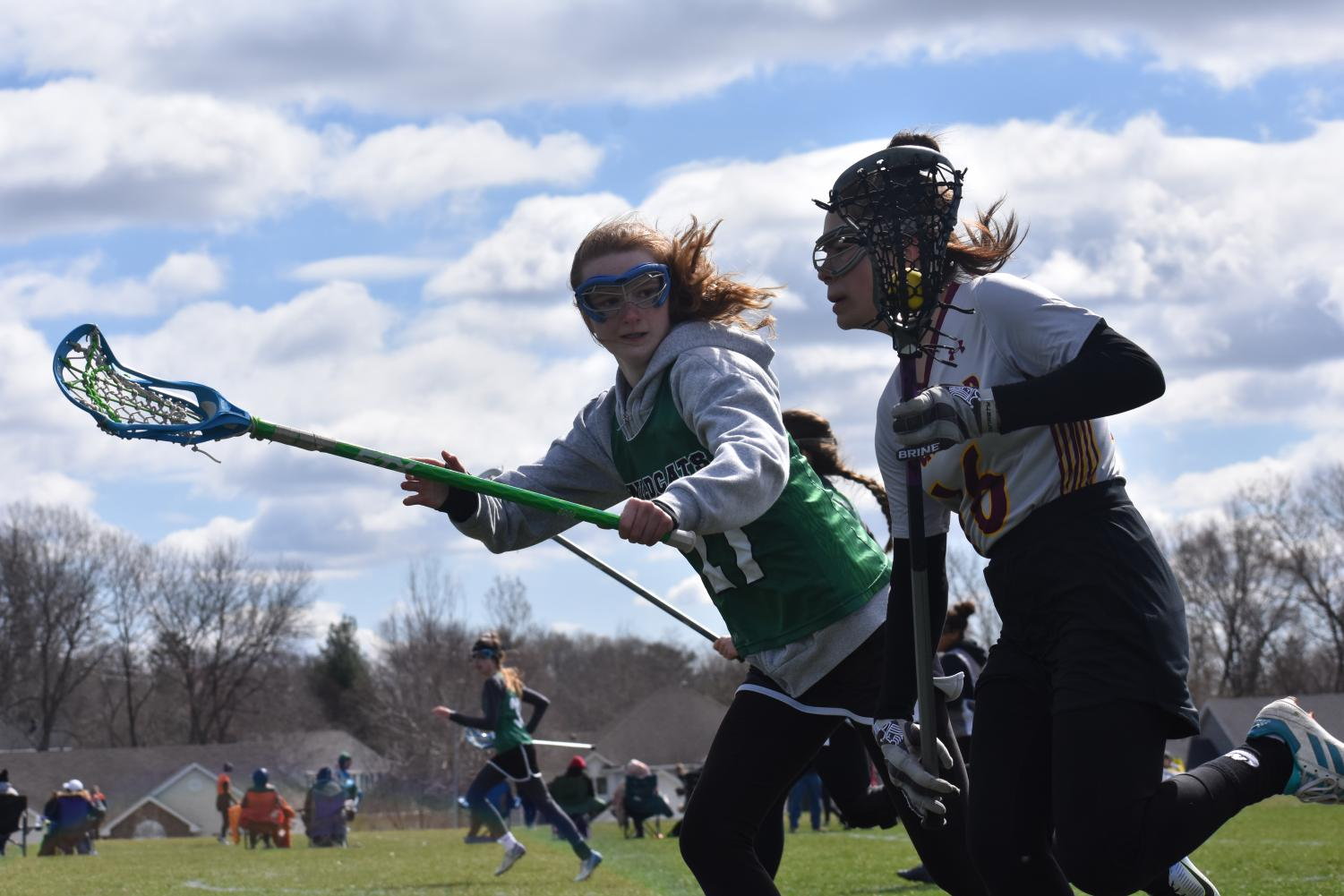 Sophomore Madeleine Maw pushes her attacker towards the outside of the field.