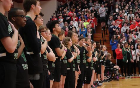 The Unified Basketball stands for the National Anthem excited and ready for the tip.