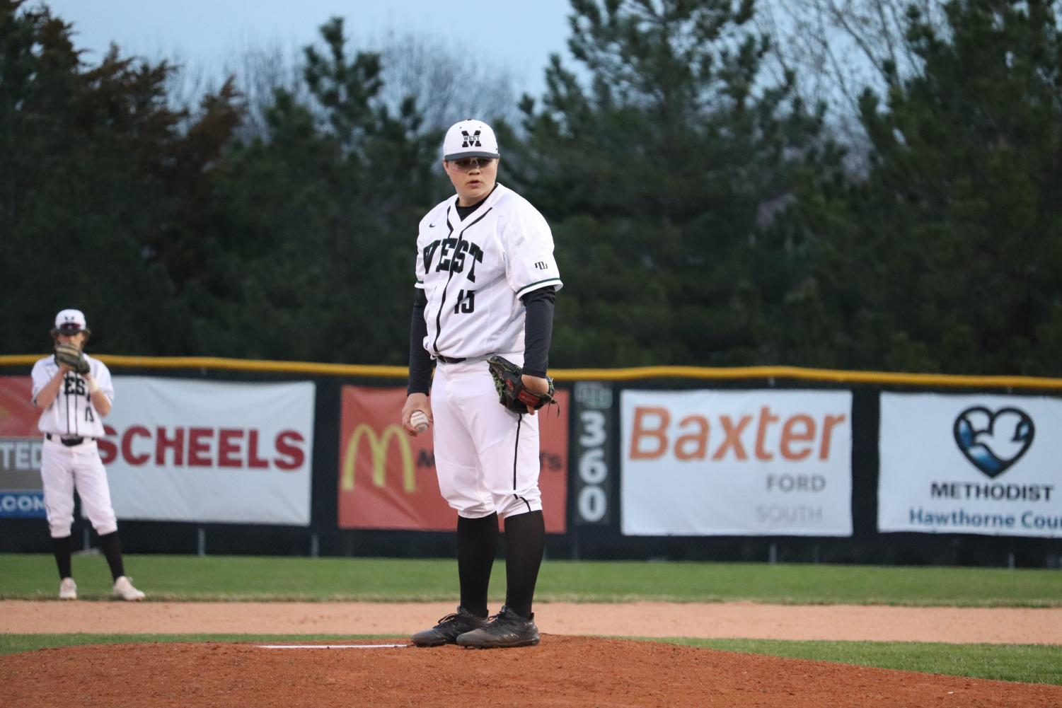 Senior+Keyton+Barnes+focusing+on+home+plate+as+he+prepares+to+pitch.