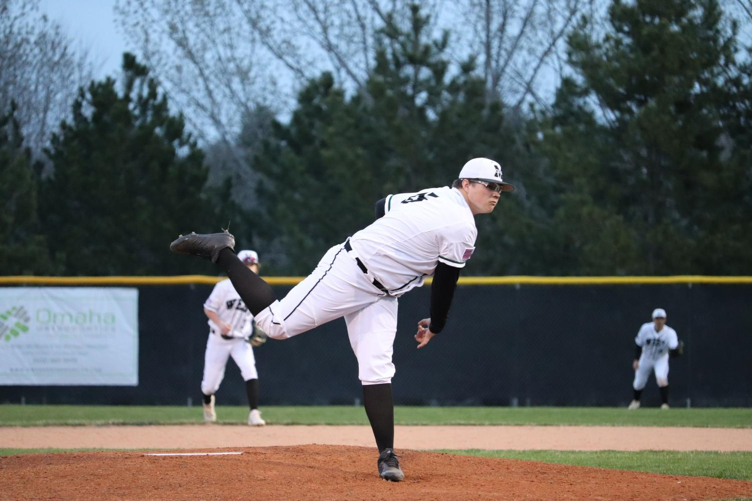 Senior+Keyton+Barnes+following+through+with+his+pitch+to+home+plate.+