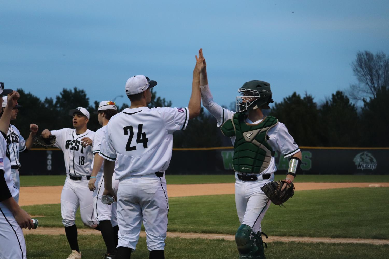 Senior+Ryan+David+congratulates+Senior+catcher%2C+Jackson+Meier%2C+on+a+well+played+inning.