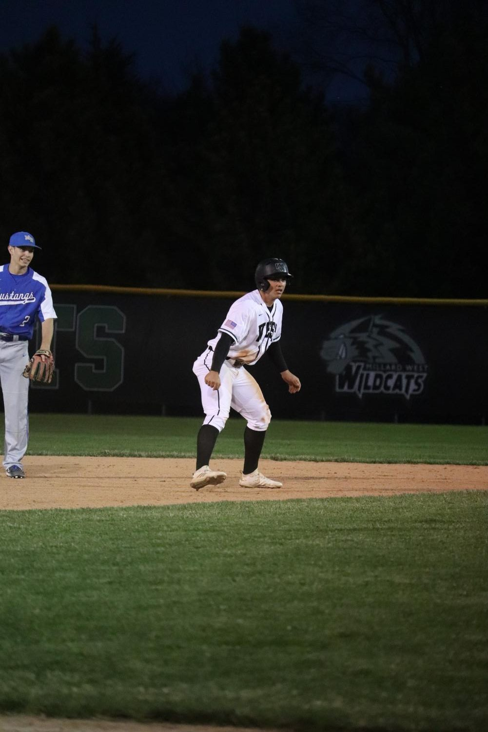 Senior+Jackson+Wright+leading+off+second+as+he+waits+for+the+pitch+to+home+plate.+