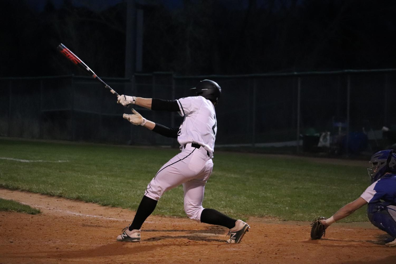 Junior+Trey+Wilbeck+finishing+through+a+swing.+