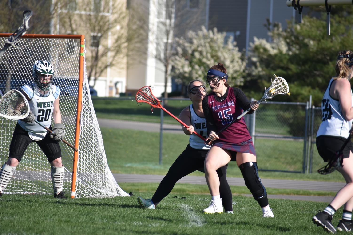 Senior+Rylie+Peterson+sticks+on+her+man+as+she+tries+to+roll+the+cage.