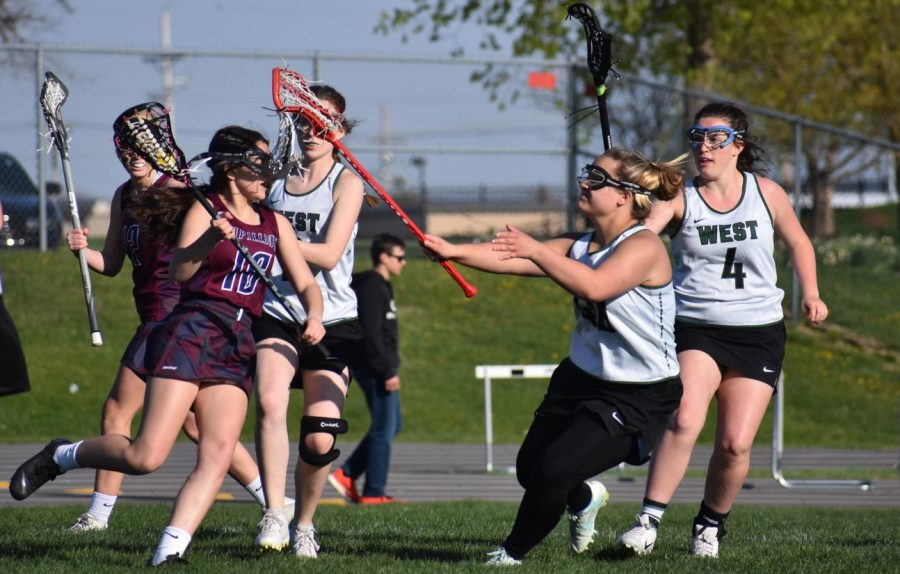 Senior Rylie Peterson stays tight on her man in attempt at a turnover.