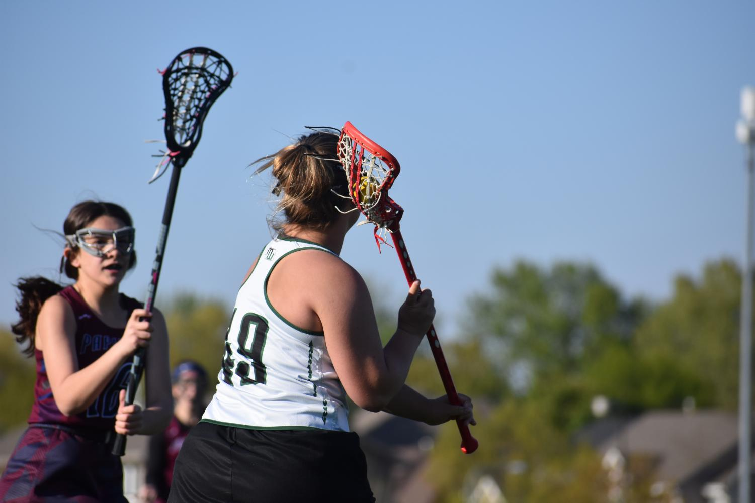 Senior+Rylie+Peterson+uses+her+outside+hand+to+throw+around+her+defender.