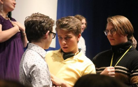 "Standing among the audience, sophomore Edison Geiler grabs his scene partners arm. Geiler played a character named Will Willard, a flamboyant young man. ""I was really just in the moment,"" Geiler said. ""I saw the sparkle in my partner's eyes and I knew the scene was going to be great."""