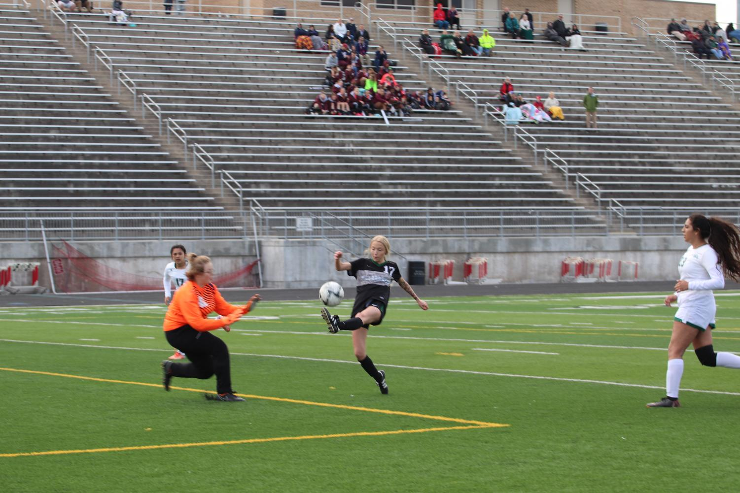 Junior Sierra Schmidt looks to chip the keeper during Millard West's 16-0 win over Omaha Benson.