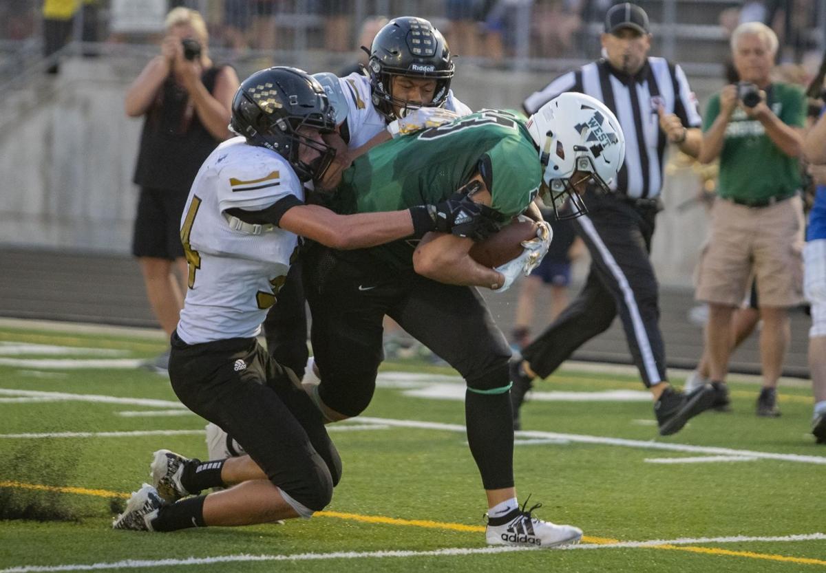 Wildcats Kaedyn Odermann catches a touchdown pass in the Wildcats 24-7 win over Omaha Burke Friday