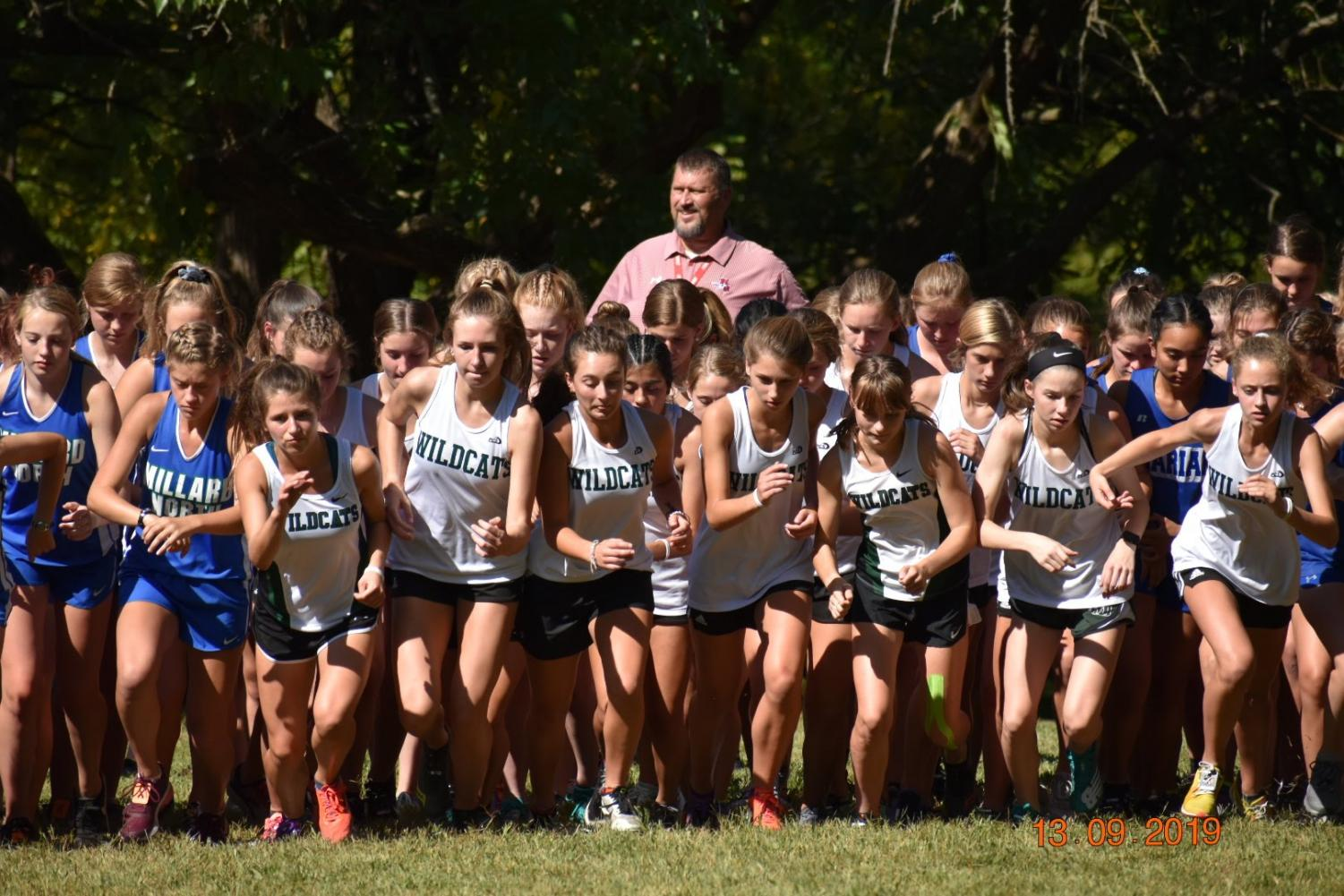 The Wildcats girls ready for their race. The runners all wanted their times close together and to run together so they would do better in their race.