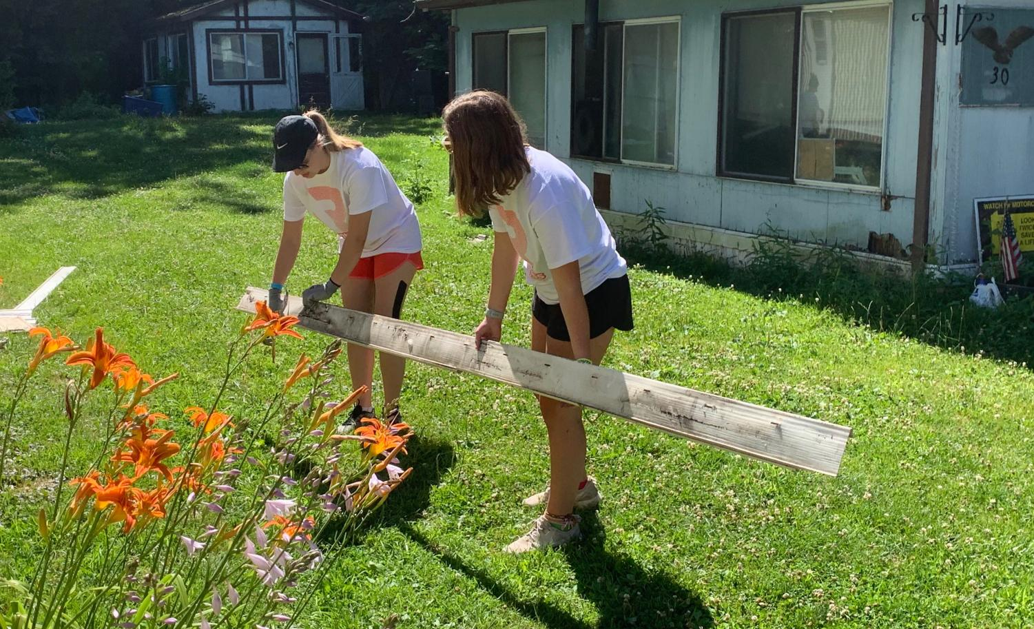 Junior Erica Michel and another volunteer are working hard at building houses for the people in Erie, Pennsylvania.