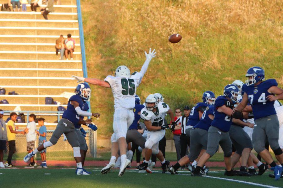 Senior defensive lineman Dane Christiansen blocking the football.