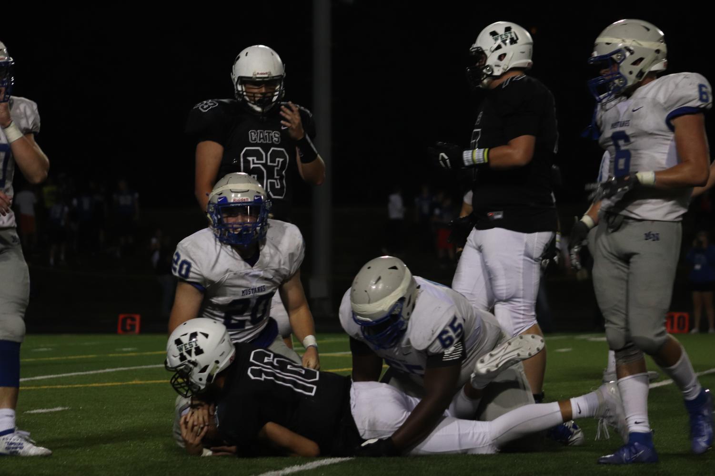 Senior+quarterback+Tristan+Gomes+getting+tackled+