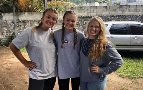 """Smiling through the brutal heat sophomore Riley Hurts stops to take a picture with her friends Lilli Rooks and Mali Rose. The three girls spent their summer helping rebuild homes in Guatemala. """"It was a really fun way to spend a part of my summer,"""" Hurts said. """"I want to go back or at least do something similar in the future."""""""