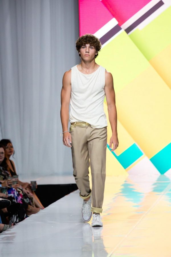 Junior Sam Falter walks on the runway for Omaha Fashion Week designer Paulie Gibson. When I prepare for the week, I make sure my hair doesnt look dumb, Falter said. I usually make sure Im not breaking out. Looking the part is an important step in getting ready for the big week; designers prepare their lines, and models get fitted for the final runs.