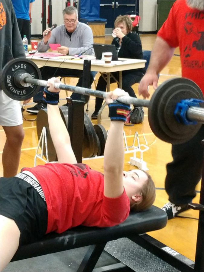"""At her second meet of the season Sophomore Peyton Busteed benches 110 pounds. At the Central High School meet she placed fifth and lifted a total of 568 pounds. """"Bench press is the lift I need to improve on the most,"""" Busteed said. """"I have been working really hard and I am starting to improve more and more each week"""""""