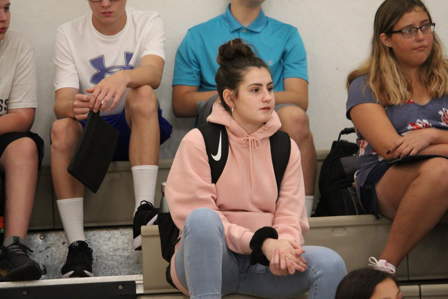Freshmen Rachael Heaton sits in the bleachers of Wildcat 1 during the Wildcat Welcome on the first day of school.