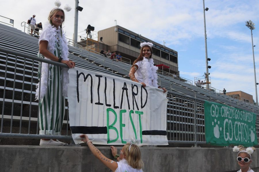 Crazies setting up posters before the game