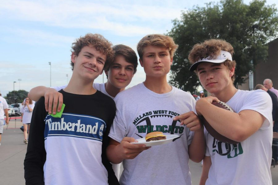 Freshmen hanging out at the tailgate