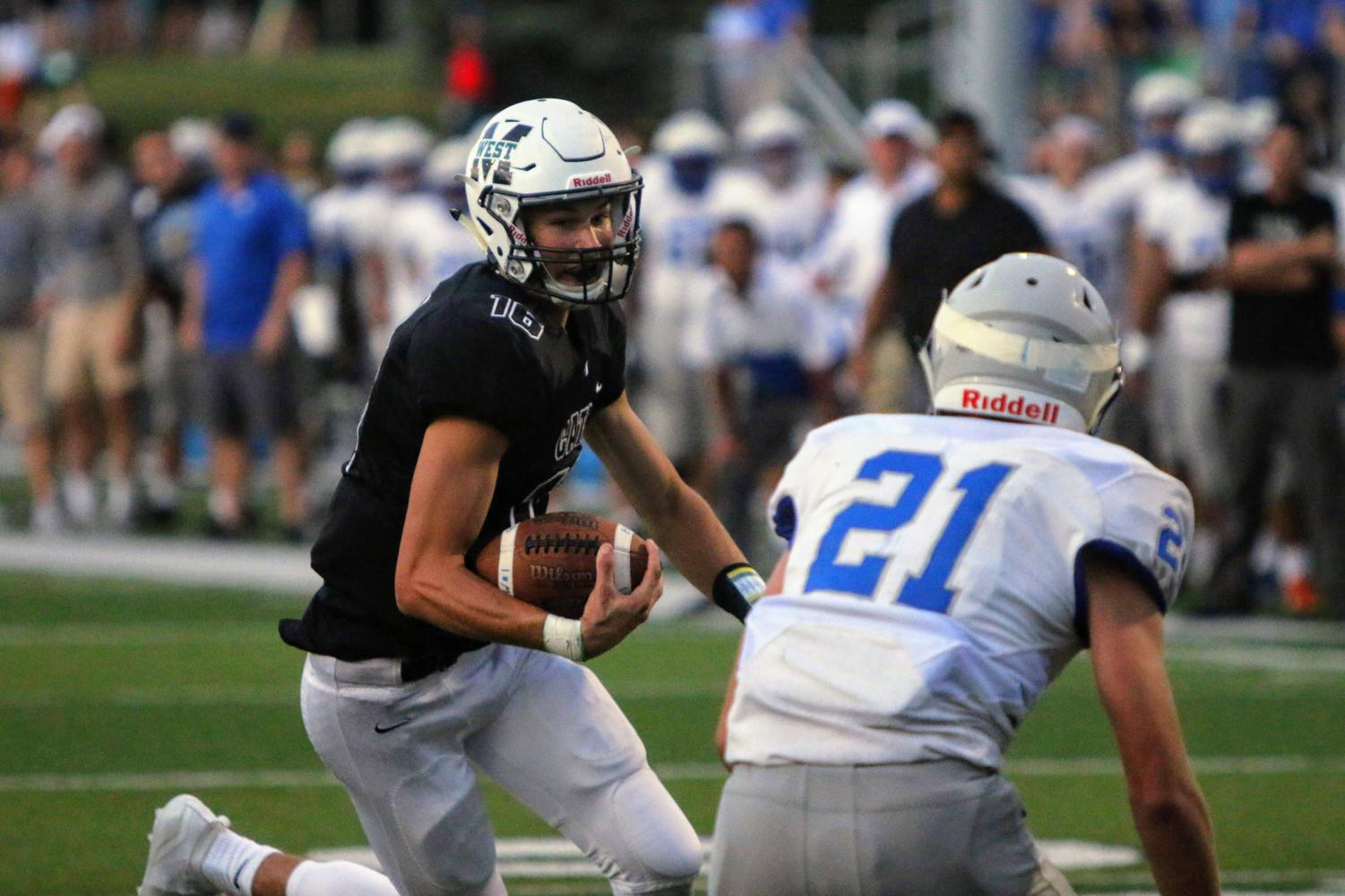 Senior quaterback Tristan Gomes trying to outrun a defender to score the touchdown. Gomes had four rushing touchdowns that night and was the only person on the team to score touchdowns Friday night.